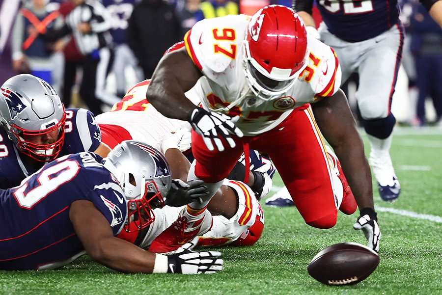 FOXBOROUGH, MA - OCTOBER 14: Allen Bailey of the Kansas City Chiefs recovers a fumble in the third quarter of a game against the New England Patriots at Gillette Stadium. (Photo by Adam Glanzman/Getty Images)