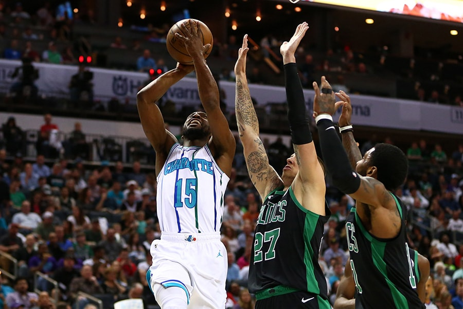 Mar 23, 2019; Charlotte, NC: Charlotte Hornets guard Kemba Walker shoots the ball against Boston Celtics forward Daniel Theis in the first half at Spectrum Center. (Jeremy Brevard-USA TODAY Sports)