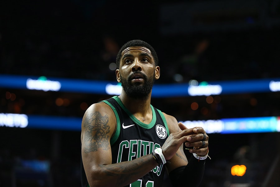 Mar 23, 2019; Charlotte, NC: Boston Celtics guard Kyrie Irving stands on the court in the first half against the Charlotte Hornets at Spectrum Center. (Jeremy Brevard-USA TODAY Sports)