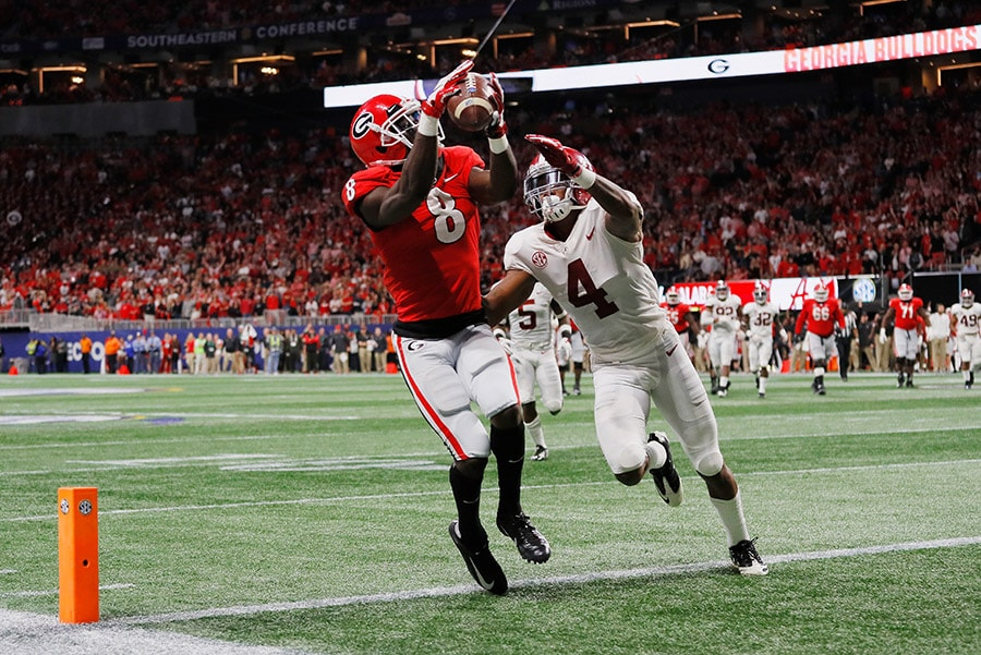 ATLANTA, GA - DECEMBER 01: Riley Ridley of the Georgia Bulldogs catches a touchdown pass against Saivion Smith of the Alabama Crimson Tide in the third quarter during the 2018 SEC Championship Game at Mercedes-Benz Stadium. (Photo by Kevin C. Cox/Getty Images)