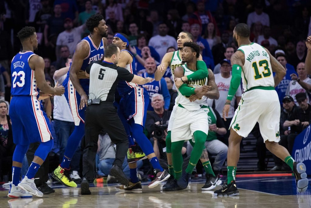 Sixers center Joel Embiid and Celtics guard Marcus Smart are separated by teammates after an altercation. (Bill Streicher-USA TODAY)