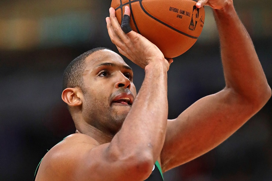 Al Horford of the Boston Celtics shoots a free throw against the Chicago Bulls at the United Center on December 11, 2017 in Chicago, Illinois. The Bulls defeated the Celtics 108-85. (Photo by Jonathan Daniel/Getty Images)