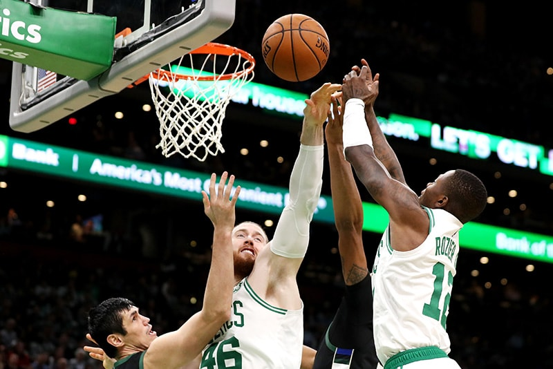 Aron Baynes of the Boston Celtics and Terry Rozier reach for a rebound over Ersan Ilyasova of the Milwaukee Bucks during the second half at TD Garden on November 1, 2018 in Boston, Massachusetts. (Photo by Maddie Meyer/Getty Images)