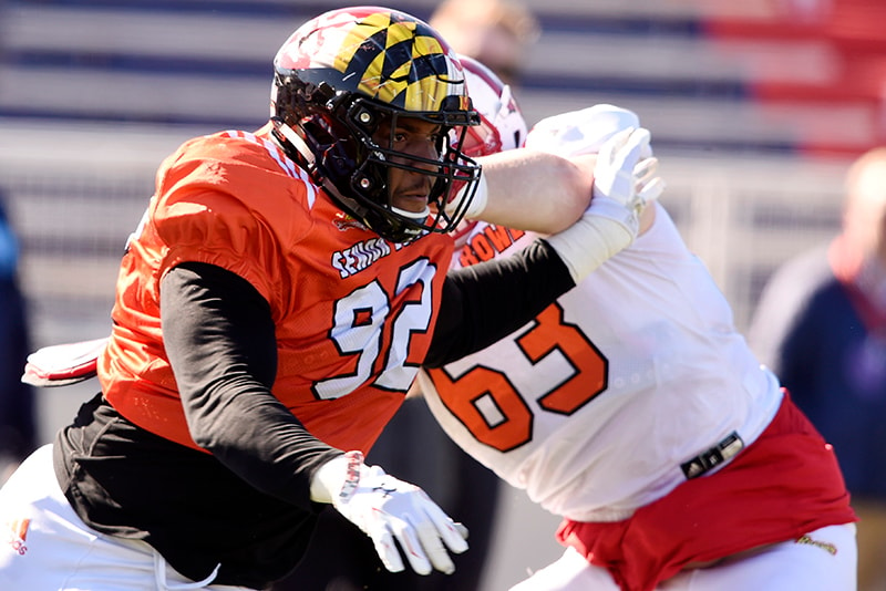 Jan 24, 2019; Mobile, AL: North defensive end Byron Cowart of Maryland fends off a block by North offensive guard Michael Deiter of Wisconsin during the North squad 2019 Senior Bowl practice at Ladd-Peebles Stadium. (John David Mercer-USA TODAY Sports)