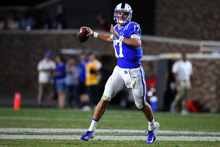 DURHAM, NC - SEPTEMBER 29: Daniel Jones of the Duke Blue Devils rolls out against the Virginia Tech Hokies during their game at Wallace Wade Stadium. Virginia Tech won 31-14. (Photo by Grant Halverson/Getty Images)
