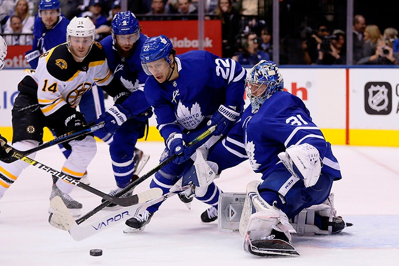 Apr 15, 2019; Toronto, Ontario, CAN: Toronto Maple Leafs goaltender Frederik Andersen and defenseman Nikita Zaitsev go after a loose puck as Boston Bruins forward Chris Wagner looks on during game three of the first round of the 2019 Stanley Cup Playoffs at Scotiabank Arena. (John E. Sokolowski-USA TODAY Sports)