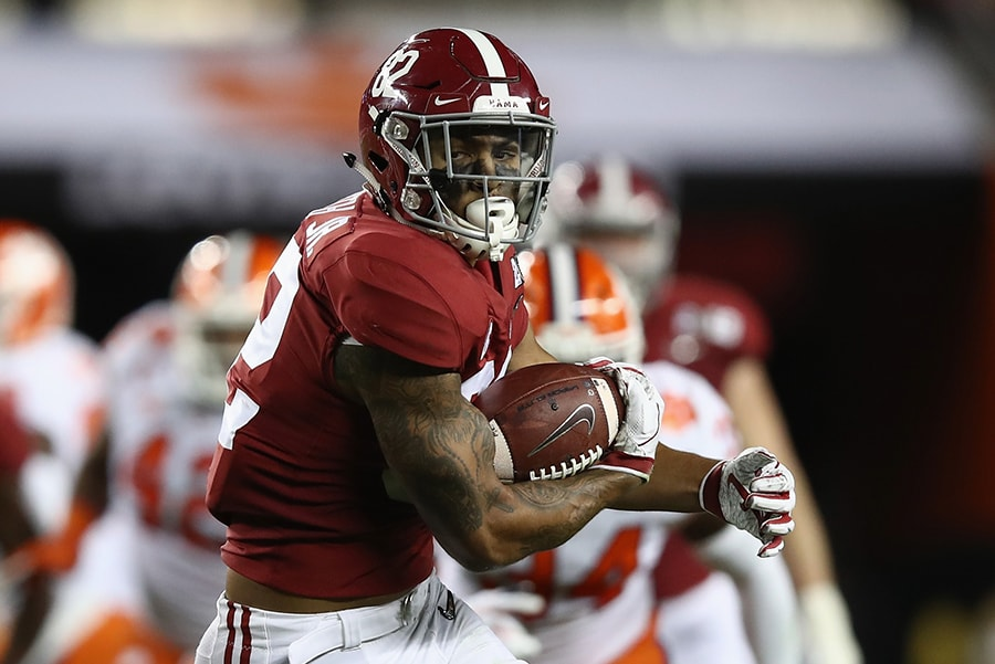 SANTA CLARA, CA - JANUARY 07: Irv Smith Jr. of the Alabama Crimson Tide carries the ball against the Clemson Tigers in the CFP National Championship presented by AT&T at Levi's Stadium. (Photo by Ezra Shaw/Getty Images)
