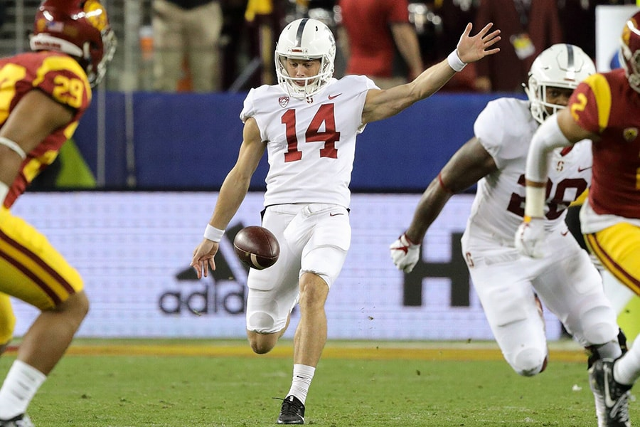 Stanford punter Jake Bailey executes a punt against USC. (Courtesy Stanford University Athletics)