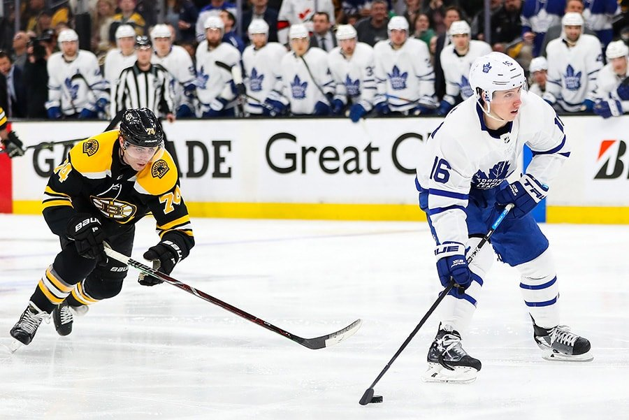 BOSTON, MA - APRIL 11: Jake DeBrusk of the Boston Bruins causes a penalty on Mitchell Marner of the Toronto Maple Leafs in the second period in Game 1 of the Eastern Conference First Round during the 2019 NHL Stanley Cup Playoffs at TD Garden. (Photo by Adam Glanzman/Getty Images)