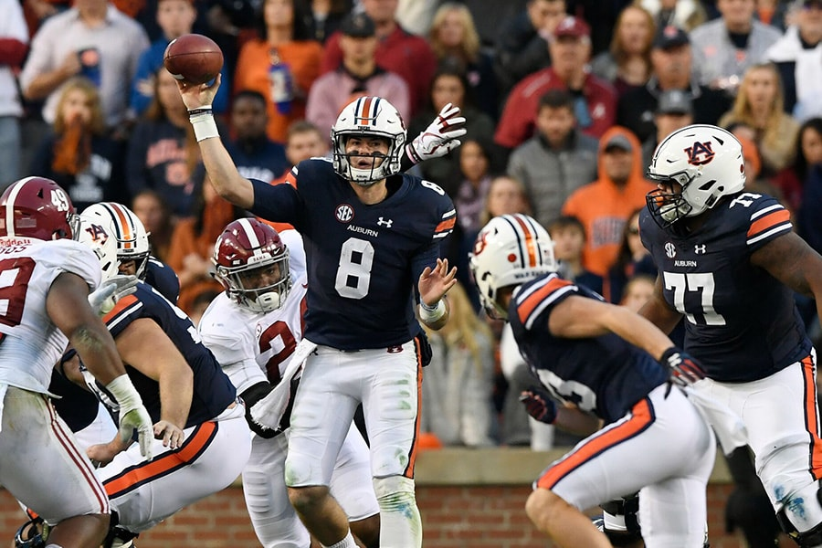 Auburn Tigerts quarterback Jarrett Stidham throws from the pocket. The New England Patriots drafted Stidham with the 133rd overall pick in the 2019 NFL Draft. (Courtesy Auburn University Athletics)