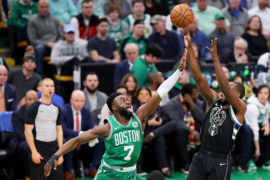 Jaylen Brown of the Boston Celtics defends a shot from Khris Middleton of the Milwaukee Bucks at TD Garden on December 21, 2018 in Boston, Massachusetts. (Photo by Maddie Meyer/Getty Images)