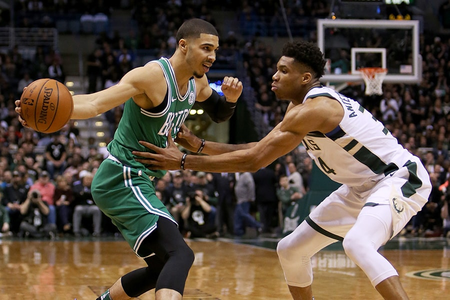 Jayson Tatum of the Boston Celtics dribbles the ball while being guarded by Giannis Antetokounmpo of the Milwaukee Bucks in the second quarter during Game 6 of Round One of the 2018 NBA Playoffs at the Bradley Center on April 26, 2018 in Milwaukee, Wisconsin. (Photo by Dylan Buell/Getty Images)