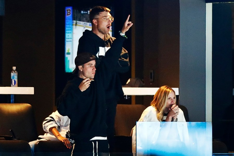 Justin Bieber reacts and guests look on during Game 7 of the Eastern Conference First Round during the 2019 NHL Stanley Cup Playoffs between the Boston Bruins and the Toronto Maple Leafs at TD Garden on April 23, 2019 in Boston, Massachusetts. (Photo by Omar Rawlings/Getty Images)