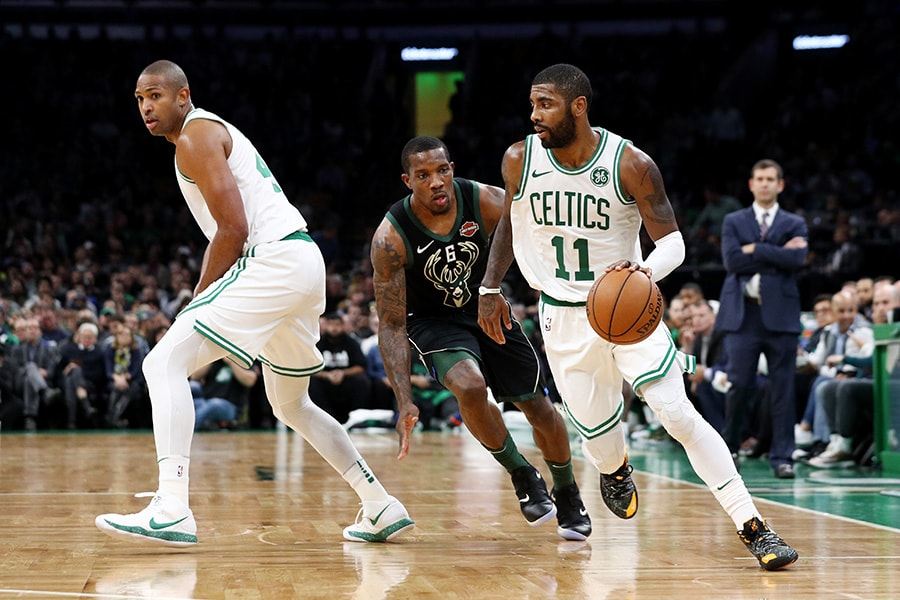 Kyrie Irving of the Boston Celtics drives against Eric Bledsoe of the Milwaukee Bucks at TD Garden on November 1, 2018 in Boston, Massachusetts. (Photo by Maddie Meyer/Getty Images)