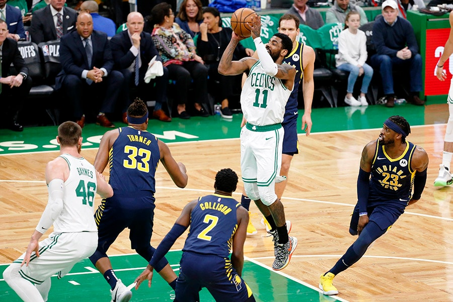 Apr 17, 2019; Boston, MA: Boston Celtics guard Kyrie Irving takes a shot while defended by Indiana Pacers guard Darren Collison and center Myles Turner during the first half in game two of the first round of the 2019 NBA Playoffs at TD Garden. (Greg M. Cooper-USA TODAY Sports)