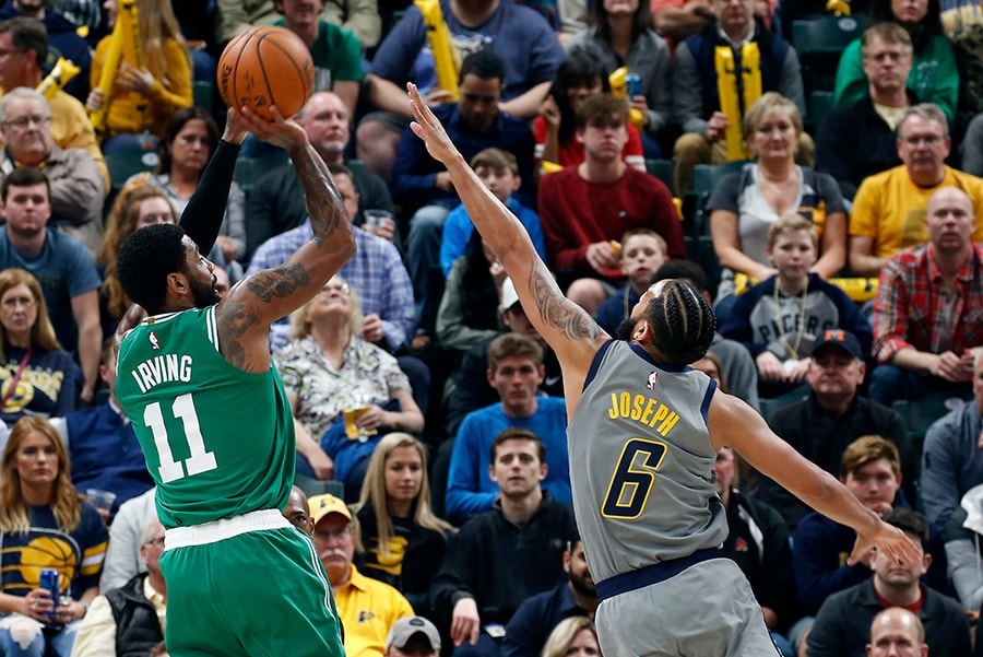 Apr 5, 2019; Indianapolis, IN: Boston Celtics guard Kyrie Irving takes a shot against Indiana Pacers guard Cory Joseph during the first quarter at Bankers Life Fieldhouse. (Brian Spurlock-USA TODAY Sports)
