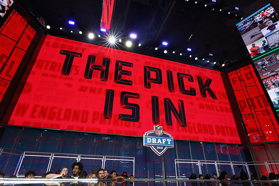 "A video board displays the text ""THE PICK IS IN"" for the New England Patriots during the first round of the 2018 NFL Draft at AT&T Stadium on April 26, 2018 in Arlington, Texas. (Photo by Ronald Martinez/Getty Images)"