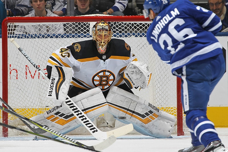 TORONTO, ON - JANUARY 12: Tuukka Rask of the Boston Bruins faces a shot from Parl Lindholm of the Toronto Maple Leafs during an NHL game at Scotiabank Arena. The Bruins defeated the Maple Leafs 3-2. (Photo by Claus Andersen/Getty Images)