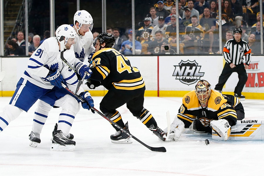 Apr 19, 2019; Boston, MA: Boston Bruins goaltender Tuukka Rask makes a save in front of Bruins defenseman Torey Krug and Toronto Maple Leafs center John Tavares during the first period in Game 5 of the first round of the 2019 Stanley Cup Playoffs at TD Garden. (Greg M. Cooper-USA TODAY Sports)