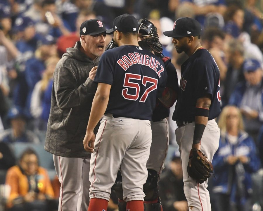 Oct 27, 2018; Los Angeles, CA, USA; Boston Red Sox pitcher Eduardo Rodriguez talks with pitching coach Dana LeVangie in the sixth inning in Game 4 of the 2018 World Series at Dodger Stadium. (Robert Hanashiro-USA TODAY Sports)