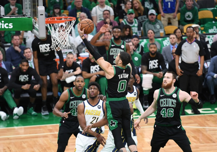 Apr 14, 2019; Boston, MA, USA; Boston Celtics forward Jayson Tatum (0) lays the ball in the basket over Indiana Pacers forward Thaddeus Young (21) during the first half in game one of the first round of the 2019 NBA Playoffs at TD Garden. Mandatory Credit: Bob DeChiara-USA TODAY Sports