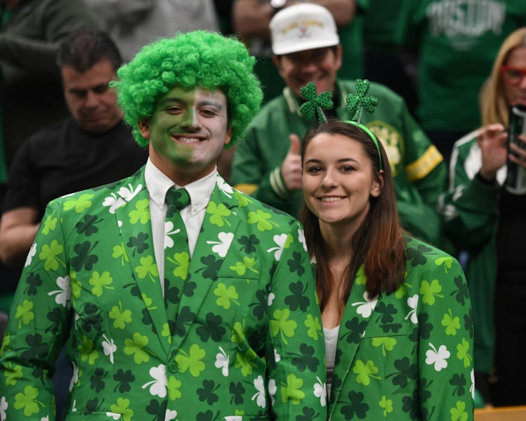 Apr 14, 2019; Boston, MA, USA; Celtics fans smile for the camera prior to game one of the first round of the 2019 NBA Playoffs against the Indiana Pacers at TD Garden. Mandatory Credit: Bob DeChiara-USA TODAY Sports