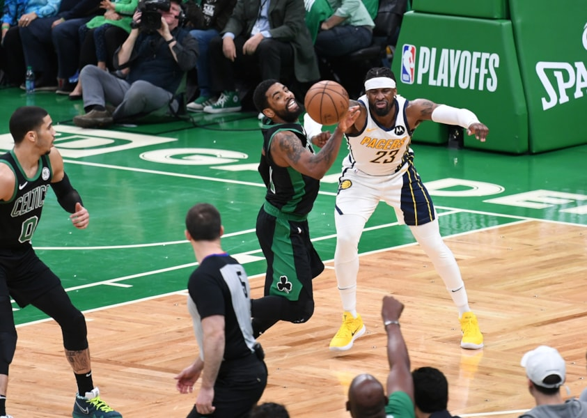 Apr 14, 2019; Boston, MA, USA; Boston Celtics guard Kyrie Irving (11) steals the ball from Indiana Pacers guard Wesley Matthews (23) during the first half in game one of the first round of the 2019 NBA Playoffs at TD Garden. Mandatory Credit: Bob DeChiara-USA TODAY Sports