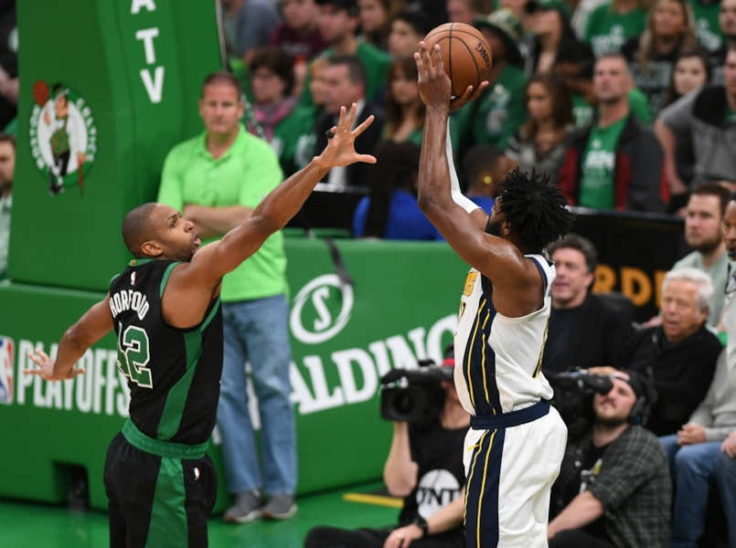 Apr 14, 2019; Boston, MA, USA; Indiana Pacers guard Tyreke Evans (12) shoots the ball over Boston Celtics center Al Horford (42) during the first half in game one of the first round of the 2019 NBA Playoffs at TD Garden. Mandatory Credit: Bob DeChiara-USA TODAY Sports