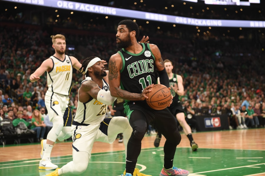 Apr 14, 2019; Boston, MA, USA; Boston Celtics guard Kyrie Irving (11) controls the ball while Indiana Pacers guard Wesley Matthews (23) defends during the second half in game one of the first round of the 2019 NBA Playoffs at TD Garden. Mandatory Credit: Bob DeChiara-USA TODAY Sports