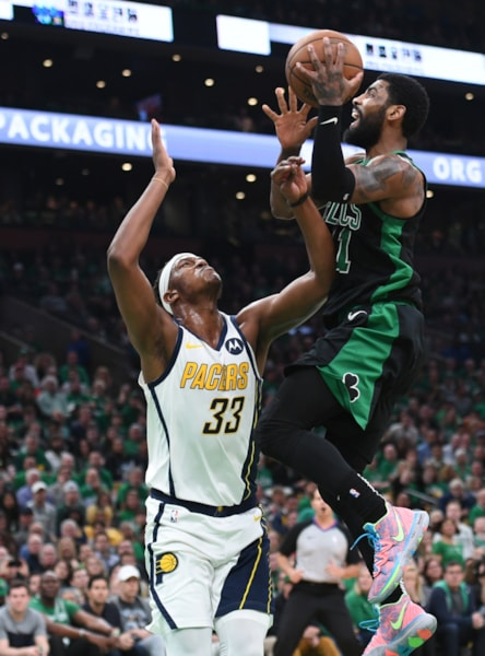 Apr 14, 2019; Boston, MA, USA; Boston Celtics guard Kyrie Irving (11) gets fouled by Indiana Pacers center Myles Turner (33) during the second half in game one of the first round of the 2019 NBA Playoffs at TD Garden. Mandatory Credit: Bob DeChiara-USA TODAY Sports