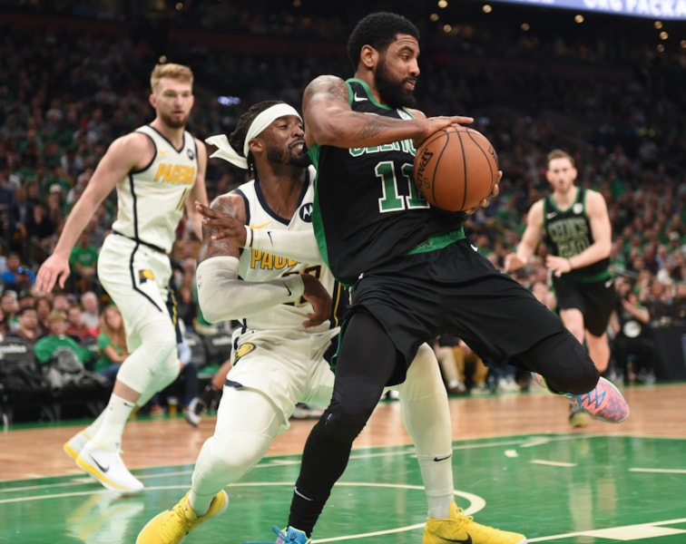 Apr 14, 2019; Boston, MA, USA; Boston Celtics guard Kyrie Irving (11) controls the ball in front of Indiana Pacers guard Wesley Matthews (23) during the second half in game one of the first round of the 2019 NBA Playoffs at TD Garden. Mandatory Credit: Bob DeChiara-USA TODAY Sports