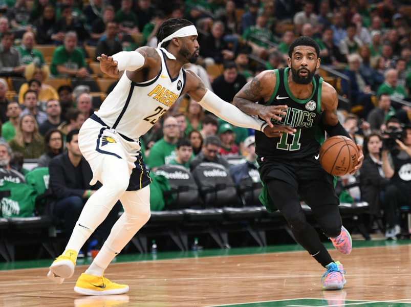 Apr 14, 2019; Boston, MA, USA; Boston Celtics guard Kyrie Irving (11) drives to the basket while Indiana Pacers guard Wesley Matthews (23) defends during the second half in game one of the first round of the 2019 NBA Playoffs at TD Garden. Mandatory Credit: Bob DeChiara-USA TODAY Sports
