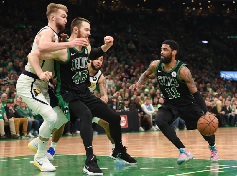 Apr 14, 2019; Boston, MA, USA; Boston Celtics guard Kyrie Irving (11) controls the ball while center Aron Baynes (46) blocks Indiana Pacers forward Domantas Sabonis (11) during the second half in game one of the first round of the 2019 NBA Playoffs at TD Garden. Mandatory Credit: Bob DeChiara-USA TODAY Sports