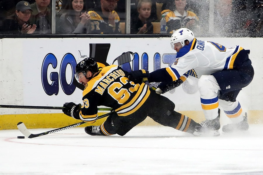 Brad Marchand of the Boston Bruins battles for the puck with Carl Gunnarsson of the St. Louis Blues during the third period in Game 2 of the 2019 NHL Stanley Cup Final at TD Garden on May 29, 2019 in Boston, Massachusetts. (Photo by Bruce Bennett/Getty Images)