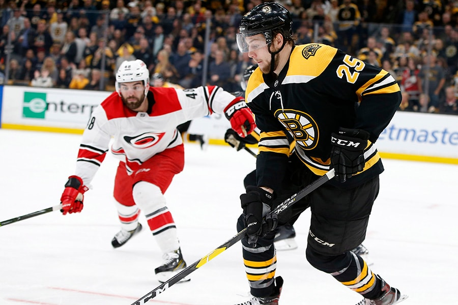May 9, 2019; Boston, MA: Boston Bruins defenseman Brandon Carlo controls the puck during the third period in Game 1 of the Eastern Conference Final of the 2019 Stanley Cup Playoffs against the Carolina Hurricanes at TD Garden. (Greg M. Cooper-USA TODAY Sports)