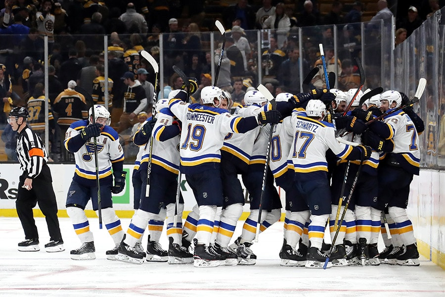 Carl Gunnarsson of the St. Louis Blues is congratulated by his teammates after scoring the game-winning goal during the first overtime period to defeat the Boston Bruins 3-2 in Game 2 of the 2019 NHL Stanley Cup Final at TD Garden on May 29, 2019 in Boston, Massachusetts. (Photo by Bruce Bennett/Getty Images)