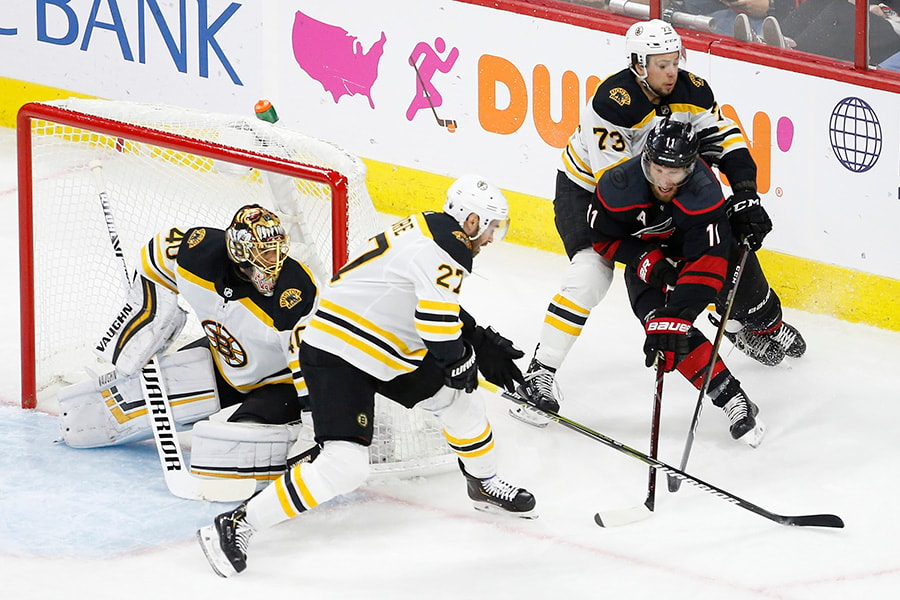 May 16, 2019; Raleigh, NC: Carolina Hurricanes center Jordan Staal shoots the puck on Boston Bruins goaltender Tuukka Rask as Boston Bruins defenseman John Moore and Bruins defenseman Charlie McAvoy in the first period in Game 4 of the Eastern Conference Final of the 2019 Stanley Cup Playoffs at PNC Arena. (Geoff Burke-USA TODAY Sports)