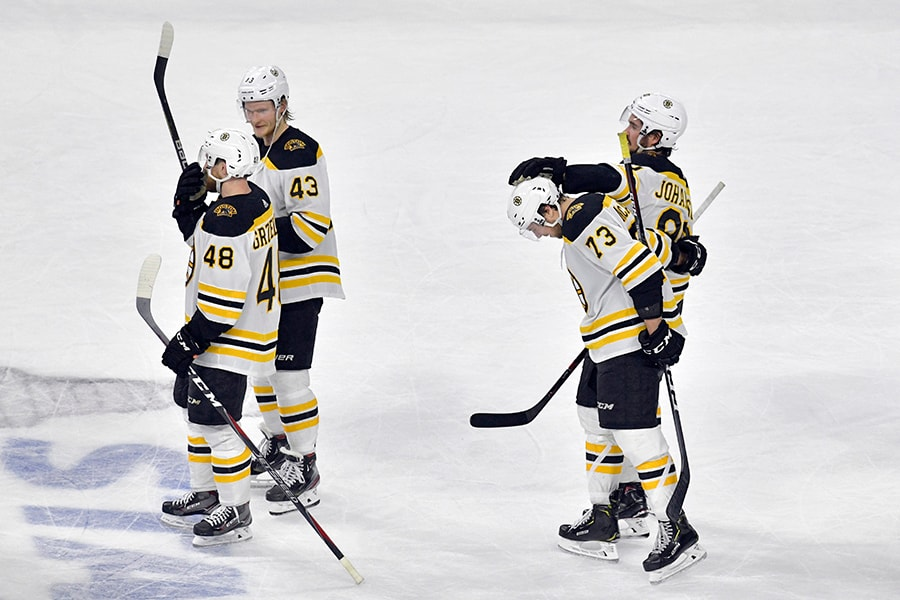 Matt Grzelcyk, Danton Heinen, Charlie McAvoy and Marcus Johansson of the Boston Bruins celebrate after defeating the Carolina Hurricanes in Game 4 to win the Eastern Conference Finals during the 2019 NHL Stanley Cup Playoffs at PNC Arena on May 16, 2019 in Raleigh, North Carolina. (Photo by Grant Halverson/Getty Images)