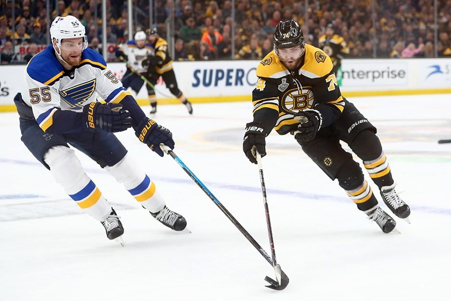 Jake DeBrusk of the Boston Bruins is defended by Colton Parayko of the St. Louis Blues during the first period in Game 2 of the 2019 NHL Stanley Cup Final at TD Garden on May 29, 2019 in Boston, Massachusetts. (Photo by Adam Glanzman/Getty Images)