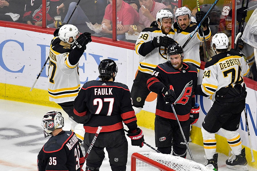 David Pastrnak of the Boston Bruins celebrates with his teammates after scoring a goal on Curtis McElhinney of the Carolina Hurricanes during the second period in Game 4 of the Eastern Conference Finals during the 2019 NHL Stanley Cup Playoffs at PNC Arena on May 16, 2019 in Raleigh, North Carolina. (Photo by Grant Halverson/Getty Images)
