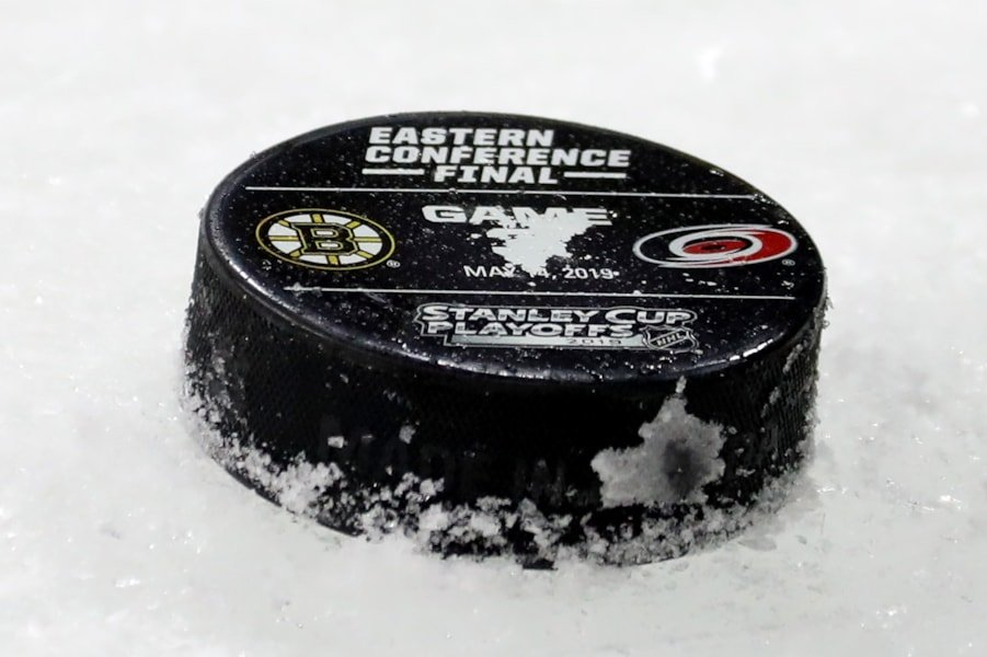RALEIGH, NORTH CAROLINA - MAY 14: A detailed view a Game Three puck on the ice prior to the Eastern Conference Finals between the Boston Bruins and the Carolina Hurricanes during the 2019 NHL Stanley Cup Playoffs at PNC Arena on May 14, 2019 in Raleigh, North Carolina. (Photo by Bruce Bennett/Getty Images)