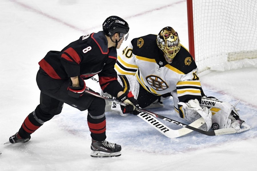 Saku Maenalanen of the Carolina Hurricanes takes a shot on Tuukka Rask of the Boston Bruins during the first period in Game Three of the Eastern Conference Finals during the 2019 NHL Stanley Cup Playoffs at PNC Arena on May 14, 2019 in Raleigh, North Carolina. (Photo by Grant Halverson/Getty Images)