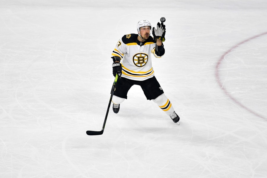RALEIGH, NORTH CAROLINA - MAY 14: Brad Marchand #63 of the Boston Bruins looks for the puck against the Carolina Hurricanes during the first period in Game Three of the Eastern Conference Finals during the 2019 NHL Stanley Cup Playoffs at PNC Arena on May 14, 2019 in Raleigh, North Carolina. (Photo by Grant Halverson/Getty Images)
