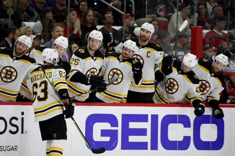 RALEIGH, NORTH CAROLINA - MAY 14: Brad Marchand #63 of the Boston Bruins celebrates with his teammates after scoring a goal on Curtis McElhinney #35 of the Carolina Hurricanes during the second period in Game Three of the Eastern Conference Finals during the 2019 NHL Stanley Cup Playoffs at PNC Arena on May 14, 2019 in Raleigh, North Carolina. (Photo by Bruce Bennett/Getty Images)