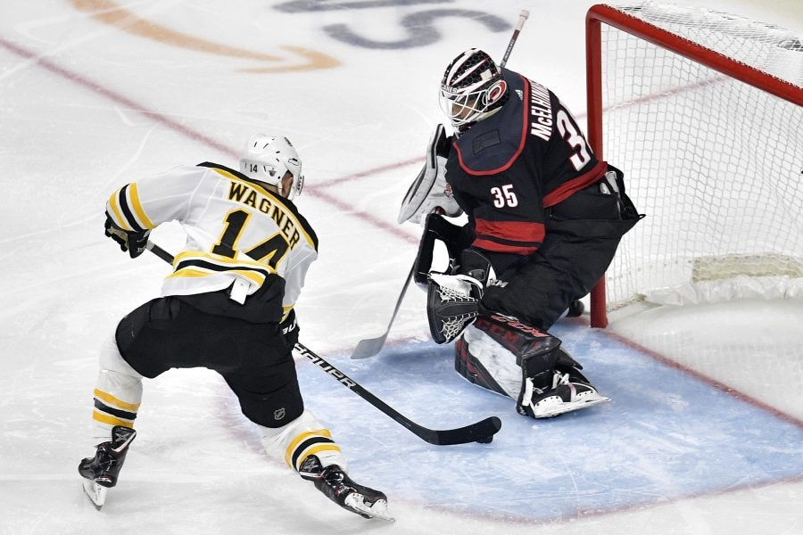 Chris Wagner of the Boston Bruins scores a goal on Curtis McElhinney of the Carolina Hurricanes during the second period in Game Three of the Eastern Conference Finals during the 2019 NHL Stanley Cup Playoffs at PNC Arena on May 14, 2019 in Raleigh, North Carolina. (Photo by Grant Halverson/Getty Images)