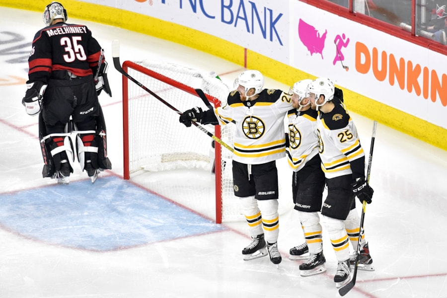 RALEIGH, NORTH CAROLINA - MAY 14: Chris Wagner #14 of the Boston Bruins celebrates with Brandon Carlo #25 and Joakim Nordstrom #20 after scoring a goal on Curtis McElhinney #35 of the Carolina Hurricanes during the second period in Game Three of the Eastern Conference Finals during the 2019 NHL Stanley Cup Playoffs at PNC Arena on May 14, 2019 in Raleigh, North Carolina. (Photo by Grant Halverson/Getty Images)