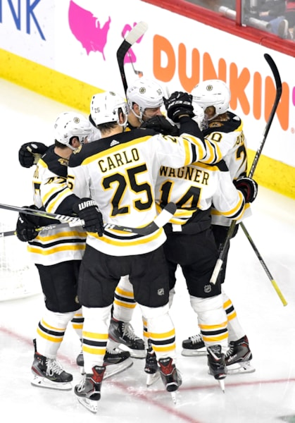RALEIGH, NORTH CAROLINA - MAY 14: Chris Wagner #14 of the Boston Bruins celebrates with his teammates after scoring a goal on Curtis McElhinney #35 of the Carolina Hurricanes during the second period in Game Three of the Eastern Conference Finals during the 2019 NHL Stanley Cup Playoffs at PNC Arena on May 14, 2019 in Raleigh, North Carolina. (Photo by Grant Halverson/Getty Images)