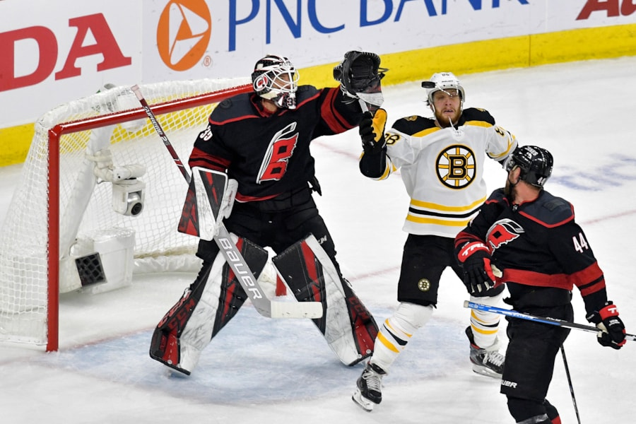 RALEIGH, NORTH CAROLINA - MAY 16: David Pastrnak #88 of the Boston Bruins looks for the puck against Curtis McElhinney #35 of the Carolina Hurricanes during the first period in Game Four of the Eastern Conference Finals during the 2019 NHL Stanley Cup Playoffs at PNC Arena on May 16, 2019 in Raleigh, North Carolina. (Photo by Grant Halverson/Getty Images)