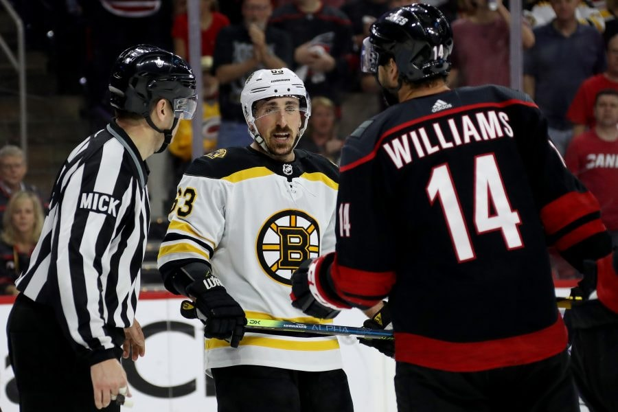 RALEIGH, NORTH CAROLINA - MAY 16: Brad Marchand #63 of the Boston Bruins argues with Justin Williams #14 of the Carolina Hurricanes during the second period in Game Four of the Eastern Conference Finals during the 2019 NHL Stanley Cup Playoffs at PNC Arena on May 16, 2019 in Raleigh, North Carolina. (Photo by Bruce Bennett/Getty Images)