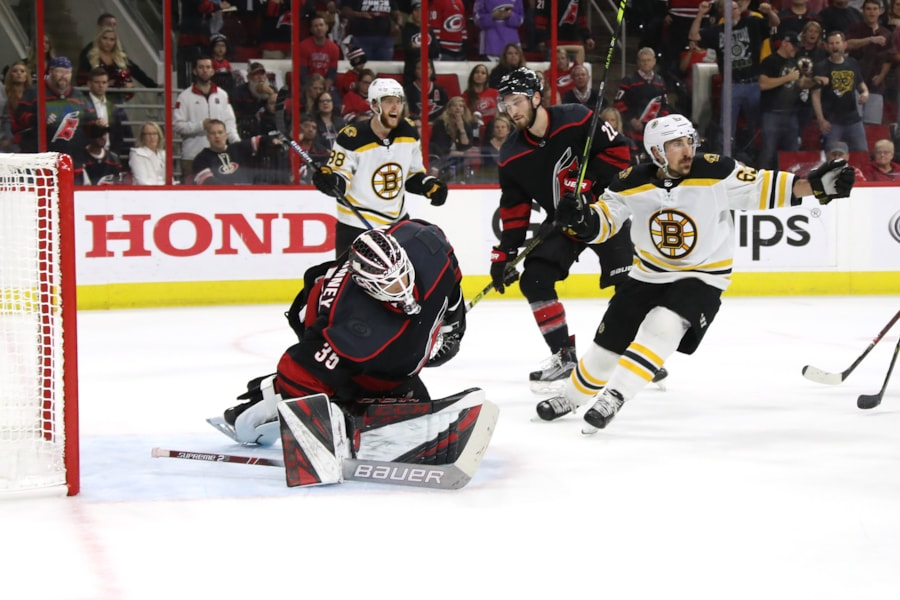 RALEIGH, NORTH CAROLINA - MAY 16: Curtis McElhinney #35 of the Carolina Hurricanes gives up a goal to Patrice Bergeron #37 of the Boston Bruins during the second period in Game Four of the Eastern Conference Finals during the 2019 NHL Stanley Cup Playoffs at PNC Arena on May 16, 2019 in Raleigh, North Carolina. (Photo by Bruce Bennett/Getty Images)